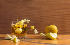 Apple and glass Stock Photos