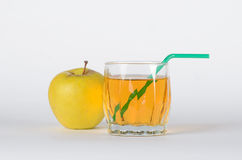 Apple with glass of juice. Green apple with the glass of juice on white background Royalty Free Stock Image