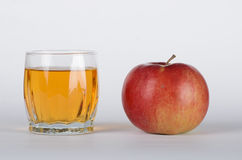 Apple with glass of juice. Red apple with the glass of juice on white background Stock Photo