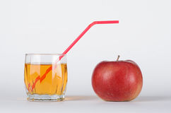 Apple with glass of juice. Red apple with the glass of juice on white background Stock Photos