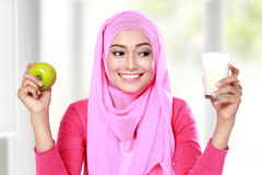 Between an apple and  a glass of milk Stock Image