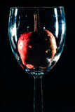 Apple in a glass Stock Photos