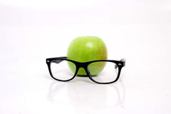 Apple with glasses Royalty Free Stock Photos