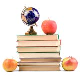 Apple, globe and books Stock Photos