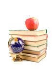 Apple, globe and books Royalty Free Stock Photography