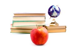 Apple, globe and books Royalty Free Stock Image