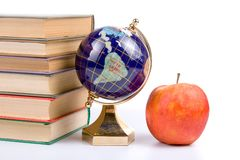 Apple, globe and books Stock Photography