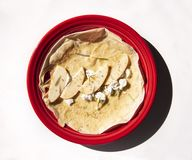 Apple goat cheese crepe on red plate stock photo
