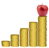 Apple on golden coins stack Stock Photo
