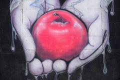 Apple grafittikonst Arkivbilder