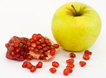 Apple and grains of garnet Stock Photography