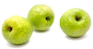 Apple Granny Smith. Group of three whole green apples Granny Smith isolated on white background n Stock Photos