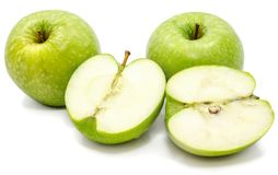 Apple Granny Smith. Halved apple Granny Smith, two whole and two halves, isolated on white background n Stock Images