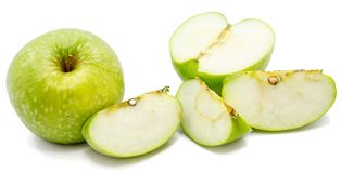 Apple Granny Smith. One whole apple Granny Smith, slices and one half, isolated on white background n Stock Images
