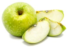 Apple Granny Smith. One whole apple Granny Smith and three slices isolated on white background Royalty Free Stock Image