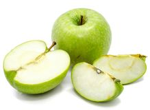 Apple Granny Smith. One whole apple Granny Smith, two slices and one half, isolated on white background n Stock Photos