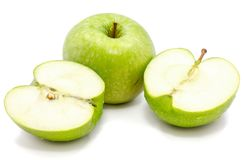 Apple Granny Smith. Sliced apple Granny Smith, one whole and two halves, isolated on white background n Stock Images