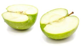 Apple Granny Smith. Sliced apple Granny Smith, two halves, isolated on white background n Stock Images