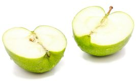 Apple Granny Smith. Sliced apple Granny Smith, two halves, isolated on white background n Stock Photo