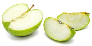 Apple Granny Smith. Sliced apple Granny Smith, two slices and one half, isolated on white background n Stock Photos