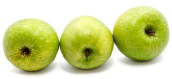 Apple Granny Smith. Sliced apple Granny Smith, two slices and one half, isolated on white background n Stock Photo