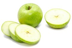 Apple Granny Smith. Sliced Granny Smith apples, one whole apple, one half and circles, isolated on white background Stock Photos
