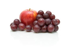 Apple and grape close-up on white background royalty free stock photography