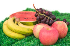 Apple, Grape, Watermelon and Banana are Fruits cool effects. On grass background Royalty Free Stock Images