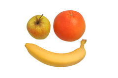 Apple, grapefruit and banana. Apple, grapefruit and a banana in the shape of the face Stock Photography