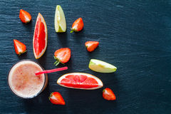 Apple grapefruit and strawberry smoothie ingredients Royalty Free Stock Images