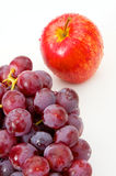 Apple and grapes Stock Images