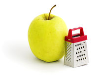 Apple and grater Stock Photo