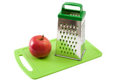 Apple and grater Stock Image