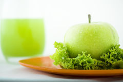 Apple and green. Green fresh apple with health vegetables Royalty Free Stock Images