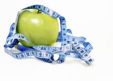 Apple on a diet stock photography