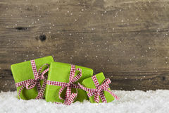 Apple green christmas presents on wooden background for a gift c Stock Photos