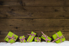 Apple green christmas presents on wooden background for a gift c Royalty Free Stock Images