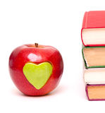 Apple with green heart and books Royalty Free Stock Image