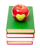 Apple with green heart on books Stock Photography