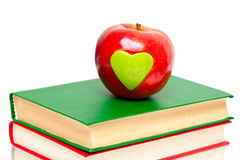 Apple with green heart on books Stock Image