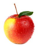 Apple with a green leaf is in drops Royalty Free Stock Image