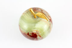 Apple. Green apple made ​​out of marble with gilded branch stock photo