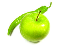 Apple and green pepper. On the white background Royalty Free Stock Photos
