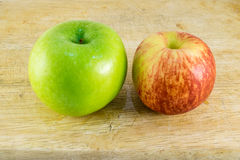 Apple. Green and red apples put on the wood background royalty free stock photo