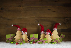 Apple green and red white checked christmas gift boxes with sant Stock Photography