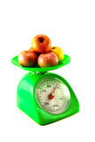 Apple on green scale. Red apple on green scale Stock Photos