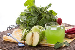 Apple and green spinach mix juice Stock Photos