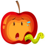 Apple with green worm inside Stock Photography