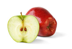 Apple and a half. Over white background stock image