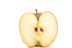 Apple Half. Photograph of an apple cut in half shot in studio and isolated on white Royalty Free Stock Images